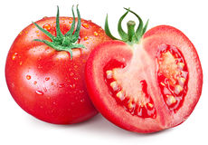 Hole tomato and half with water drops on them. Royalty Free Stock Image
