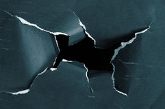 Hole torn in grunge paper Royalty Free Stock Image