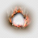 Hole torn in ripped paper with burnt and flame Royalty Free Stock Image