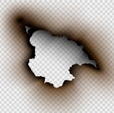 Hole torn in ripped paper with burnt and flame. On transparent background Royalty Free Stock Images