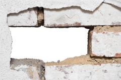 Hole in the Wall. Missing brick in a grey wall stock images