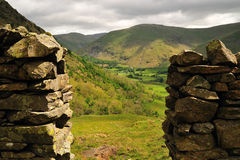 Hole in the Wall. Brotherswater Campsite viewed through a hole in the sandstone wall Stock Photos