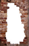 Hole in the Wall. A big hole in a very old brick wall makes an interesting frame Royalty Free Stock Photography