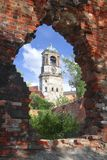 Hole in a wall-5. Hole in a wall on a background of an old chapel Stock Images