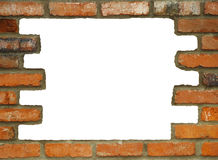 Hole in the Wall. Brick wall background in various shades of red, orange, brown, tan, and white. with a large white hole Stock Images