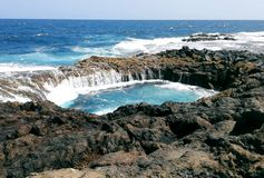 Hole in the wall. A hole in the wall where water from the ocean enters, Gran Canaria, Spain royalty free stock image