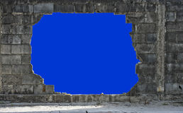 Hole in a wall isolated on blue Stock Photos