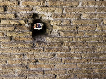 Hole in Wall at Pompeii Italy. Photograph of a hole in a wall at Pompeii. Copy space available stock photography
