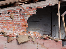 Hole in the wall of wrecked building at demolition site Royalty Free Stock Image