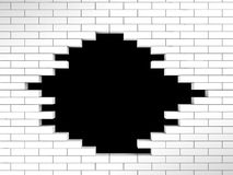 Hole in white brick wall Royalty Free Stock Photos