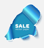 Hole in white paper with blue torn sides Stock Image