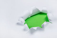 Hole in a white paper Stock Image