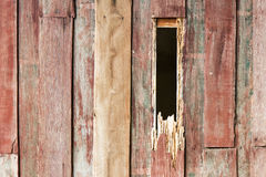 Hole wood from termites. Background wall disintegrated weathered old wooden box with holes eaten by termites Royalty Free Stock Images