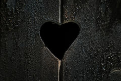 Hole at a wood window with heart shape. Wood texture with heart shape Stock Photos