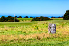 Hole wooden board. Cape Kidnappers golf court. New Zealand Royalty Free Stock Photo