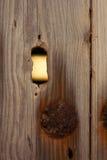 Hole in a wooden door Stock Photo