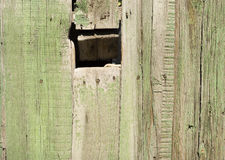 Hole in wooden fence Royalty Free Stock Photography