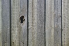 Hole on wooden fence stock images