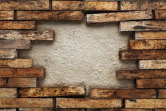 Hole in a wooden wall Stock Images