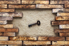 Hole in a wooden wall. With a key Stock Images
