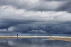 Holender chmurnieje z łodzią rybacką Obraz Royalty Free