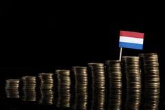 Holender flaga z udziałem monety odizolowywać na czerni Zdjęcie Royalty Free