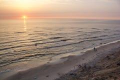 Holendera ` s nakrętki plaży piaska morze I Zadziwiający wieczór zmierzch Fotografia Royalty Free