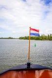 Holenderska flaga państowowa na stern łódź Zdjęcie Stock
