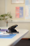 Holepunch in office. Black holepunch on an office desk Stock Photography