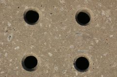 Holes 01. A concrete paving slab with drainage holes Royalty Free Stock Image
