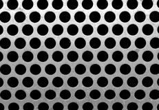 Holes. Metal plate with round holes stock photo