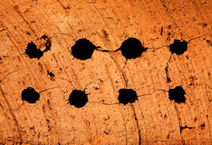 Holes in a brick. Holes in a solid red brick Royalty Free Stock Photography