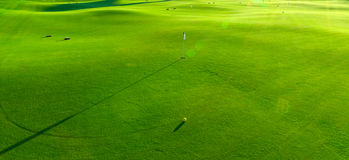 Holes and bunkers on the golf course. Photo golf courses with bright green grass Royalty Free Stock Photo