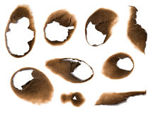 Holes burned in paper stock images
