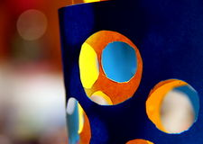 Holes. Composition of carved colored papers in  yellow and blue Royalty Free Stock Photography