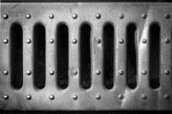 Holes in a iron tin plate Royalty Free Stock Photo
