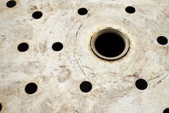 Holes in metal. Royalty Free Stock Images
