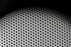 Holes in Metal Macro Background. Royalty Free Stock Photography