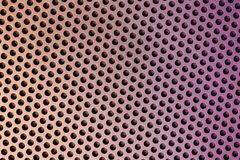Holes in Metal Macro Background. Stock Images