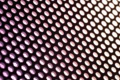 Holes in Metal Macro Background. Stock Photo