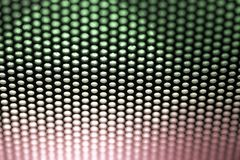 Holes in Metal Macro Background. Royalty Free Stock Photo