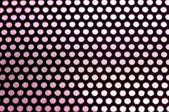 Holes in Metal Macro Background. Royalty Free Stock Image