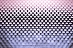 Holes in Metal Macro Background. Stock Photos