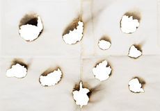 Holes in a paper Stock Images