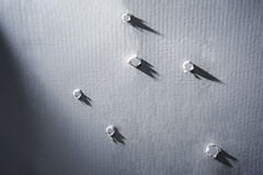 Holes in paper. Shot imitation. Royalty Free Stock Photo