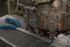 Holes are punched by machine in metal parts Royalty Free Stock Photo