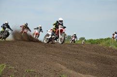 Holeshot partie le groupe de motocross de curseurs Photos libres de droits