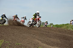 Holeshot parts motocross group of riders Royalty Free Stock Photos
