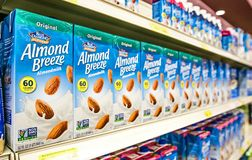 Almond Breeze. Holetown, Barbados, 03-19-2018: Cartons of Blue Diamond Almond Breeze stand on a shelf of a local supermarket stock photography