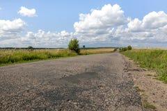 Holey asphalt road. Royalty Free Stock Images